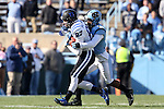 30 November 2013: Duke's Max McCaffrey (87) is tackled by UNC's Tim Scott (right). The University of North Carolina Tar Heels played the Duke University Blue Devils at Keenan Memorial Stadium in Chapel Hill, NC in a 2013 NCAA Division I Football game. Duke won the game 27-25.