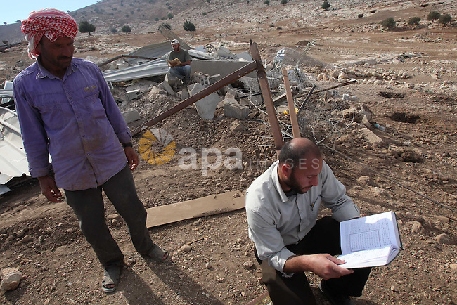 Palestinians inspect the damages in a mosque which was demolished by the Israeli army in the West Bank village of Yarza near the West Bank town of Tubas, where the army destroyed at least five buildings due to lack of Israeli permits, Friday , Nov. 26, 2010. Photo by Wagdi Eshtayah