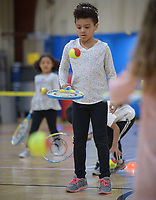 NWA Democrat-Gazette/ANDY SHUPE<br /> Dimaya Hintz, 7, (center) of Fayetteville bounces a tennis ball on her racket Tuesday, March 27, 2018, as her sister, Phoebe Hintz, 5, chases a ball while learning how to play tennis during homeschool physical education class at the Yvonne Richardson Community Center in Fayetteville.  The center hosts physical eduction classes for homeschooled children on Tuesdays and Thursdays.