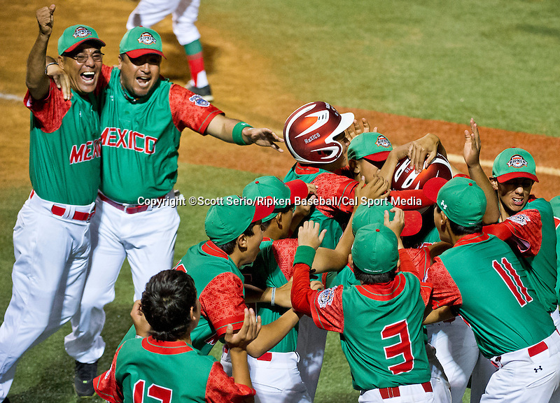 August 14, 2014: Team Mexico celebrates their come from behind 2-1 victory against Mexico in the Cal Ripken 12u 70-foot World Series International Semifinals at the Ripken Experience powered by Under Armour in Aberdeen, Maryland on August 14, 2014. Scott Serio/Ripken Baseball/CSM