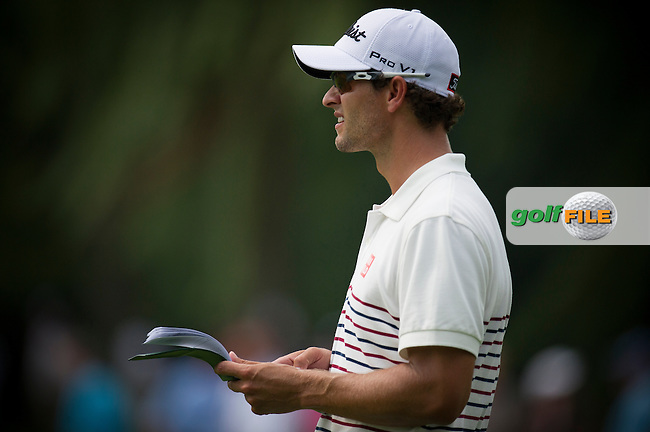 Adam Scott checks his yardages during the opening round of the PGA Championship at Oak Hill Country Club (Photo: Anthony Powter) www.golffile.ie