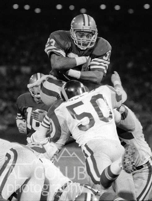 San Francisco 49ers vs. Los Angles Rams at Candlestick Park Monday, December 9, 1985..Rams beat the 49ers 27-20.San Francisco 49ers Running Back Roger Craig (33) is stopped by Los Angles Rams Linebacker Jim Collins (50)..