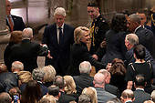 Former President Jimmy Carter, second from left, and former first lady Rosalynn Carter, left, greet former President Bill Clinton, third from left, as his wife, former Secretary of State Hillary Clinton, center, greets a guest before a State Funeral for former President George H.W. Bush at the National Cathedral, Wednesday, Dec. 5, 2018, in Washington. Also pictured is former President Barack Obama and former first lady Michelle Obama, at right.<br /> Credit: Andrew Harnik / Pool via CNP