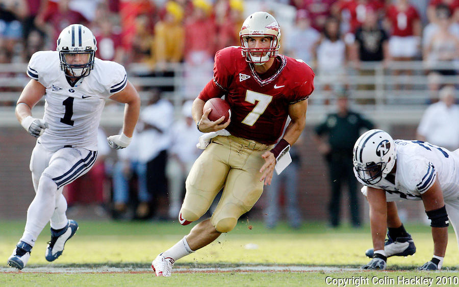TALLAHASSEE, FL 9/18/10-FSU-BYU FB10 CH-Florida State's Christian Ponder runs away from Brigham Young's Jordan Pendleton, left, and Vic So'oto during second half action Saturday at Doak Campbell Stadium in Tallahassee. The Seminoles beat the Cougars 34-10..COLIN HACKLEY PHOTO