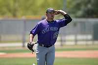 Colorado Rockies relief pitcher Reagan Biechler (95) makes a throw to first base during an Extended Spring Training game against the Chicago Cubs at Sloan Park on April 17, 2018 in Mesa, Arizona. (Zachary Lucy/Four Seam Images)