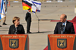 German Chancellor Angela Merkel with Israeli Prime Minister Ehud Olmert, during a welcoming ceremony at Ben Gurion airport in Israel, Sunday, March 16, 2008.<br />