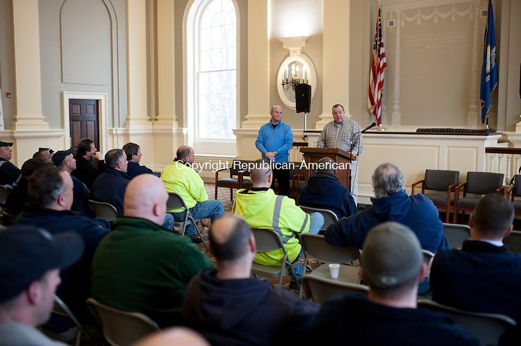 WATERBURY, CT-26 January 2015-012615EC10-   Waterbury Mayor Neil O'Leary gives a pep talk to a room full of DPW employees Monday afternoon at City Hall ahead of the storm. O'Leary told workers to stay safe, use their best judgment and help residents out. The mayor also gave workers pizza to thank them for their hard work. Erin Covey Republican-American