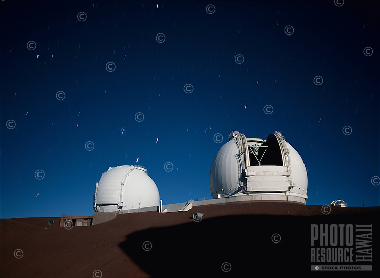 Keck Telescope, Mauna Kea, Hawaii, in moonlight.The twin telescopes of the W.M. Keck Observatory seen in the light of the Full Moon.