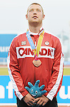November 17 2011 - Guadalajara, Mexico:  Alister McQueen receiving his Bronze medal for Men's Javelin - F44 in the Telmex Athletic's Stadium at the 2011 Parapan American Games in Guadalajara, Mexico.  Photos: Matthew Murnaghan/Canadian Paralympic Committee