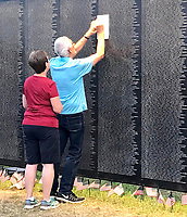 Sally Carroll/McDonald County Press<br /> Those with loved ones and friends who died in the Vietnam War were able to rub their name onto a piece of paper at The Wall That Heals traveling exhibit. The replica of the Vietnam Veterans Wall lists all the names of the those who died during the Vietnam War. The exhibit recently came to Bentonville, Ark.