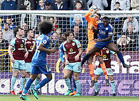 Burnley's Nick Pope collects under pressure from Leicester City's Wes Morgan<br /> <br /> Photographer Rich Linley/CameraSport<br /> <br /> The Premier League - Burnley v Leicester City - Saturday 14th April 2018 - Turf Moor - Burnley<br /> <br /> World Copyright &copy; 2018 CameraSport. All rights reserved. 43 Linden Ave. Countesthorpe. Leicester. England. LE8 5PG - Tel: +44 (0) 116 277 4147 - admin@camerasport.com - www.camerasport.com