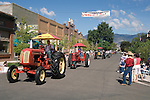 Dick Weaton drives his Cockshutt tractor during the Carson Valley Days parade downtown Minden, Nevada. A Farmall and Oliver tractors follow.