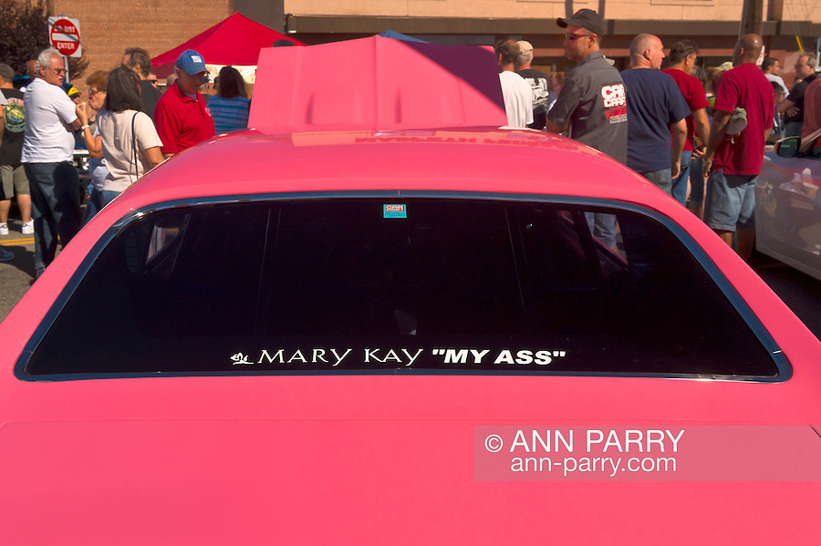 Sept. 15, 2012 - New Hyde Park, New York, U.S. - The owner of this Chevy Chevelle SS, with bubblegum pink color, has info written on rear window so people will know it is not a pink car given out by Mary Kay company, at the New York AutoFest at New Hyde Park Car Show and Street Fair.
