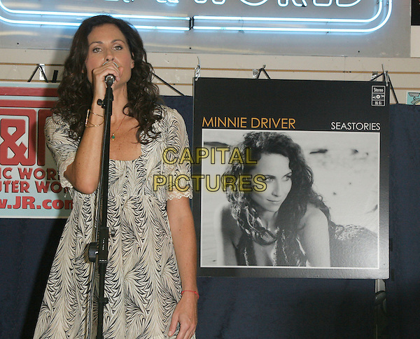 "MINNIE DRIVER.In-Store appearance promoting her new CD, ""Seastories"".at J&R Music World, New York, NY, USA, July 25, 2007..half length cream and black print dress performing singing.CAP/LNC/JOS.©LNC/Capital Pictures."