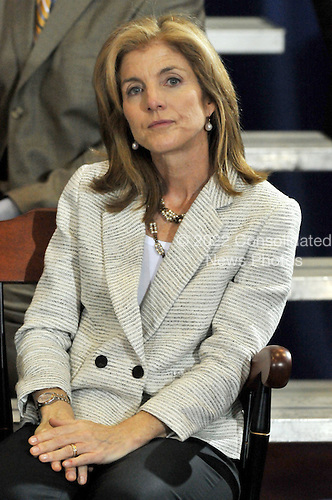 Washington, D.C. - April 21, 2009 -- Caroline Kennedy listens as United States President Barack Obama makes remarks at the signing ceremony for the Edward M. Kennedy Serve America Act at the SEED School in Washington, D.C. on Tuesday, April 21, 2009..Credit: Ron Sachs / CNP