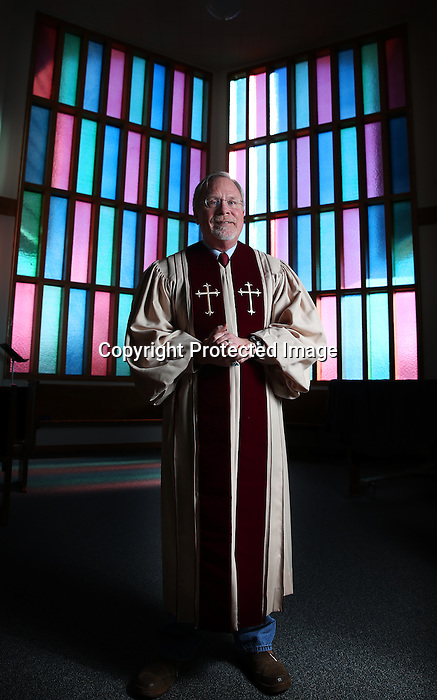 """Social advocate and pastor Rodger McDaniel stands in his church earlier this week. McDaniel has led countless protests for human rights at the capitol and said of his advocacy """"It's ok to be the voice in the wilderness.' """"I have a sense that the whole community is your own backyard. It's comfortable and everything like our parks are so well taken care of.' Said McDaniel about living in Laramie County. Michael Smith/staff"""
