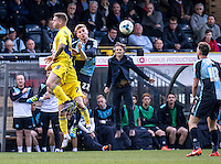 Wycombe Wanderers Manager Gareth Ainsworth goes up for a header with Jason McCarthy of Wycombe Wanderers during the Sky Bet League 2 match between Wycombe Wanderers and Accrington Stanley at Adams Park, High Wycombe, England on the 30th April 2016. Photo by Liam McAvoy / PRiME Media Images.
