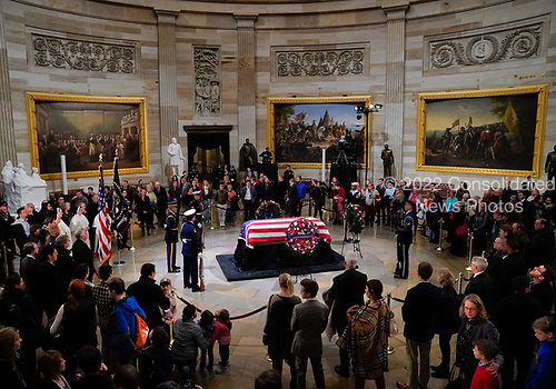 Visitors stop to pay their respects to former President George H. W. Bush, lying in state in the U.S. Capitol Rotunda Monday, Dec. 3, 2018, in Washington. (AP Photo/Pablo Martinez Monsivais/Pool)