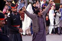 Pakistani soldier atthe border to India.<br /> Right: A pakistani demonstrator is shouting slogans against India<br /> 17.2.2001, Wagah/Punjab/Pakistan<br /> Copyright: Christian-Ditsch.de<br /> [Inhaltsveraendernde Manipulation des Fotos nur nach ausdruecklicher Genehmigung des Fotografen. Vereinbarungen ueber Abtretung von Persoenlichkeitsrechten/Model Release der abgebildeten Person/Personen liegen nicht vor. NO MODEL RELEASE! Nur fuer Redaktionelle Zwecke. Don't publish without copyright Christian-Ditsch.de, Veroeffentlichung nur mit Fotografennennung, sowie gegen Honorar, MwSt. und Beleg. Konto: I N G - D i B a, IBAN DE58500105175400192269, BIC INGDDEFFXXX, Kontakt: post@christian-ditsch.de<br /> Bei der Bearbeitung der Dateiinformationen darf die Urheberkennzeichnung in den EXIF- und  IPTC-Daten nicht entfernt werden, diese sind in digitalen Medien nach §95c UrhG rechtlich geschuetzt. Der Urhebervermerk wird gemaess §13 UrhG verlangt.]