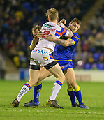 23rd March 2018, Halliwell Jones Stadium, Warrington, England; Betfred Super League rugby, Warrington Wolves versus Wakefield Trinity; Tom Johnstone is tackled by Warrington