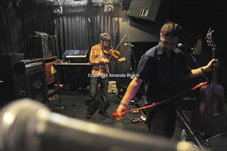 (L-R) Pet Peeve band members Mark Adkison and Lorian Toth set up before a live set at the Double Door in Chicago on June 5, 2011.