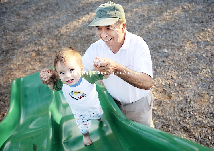 SEYMOUR, CT-- 02 July 2007--070207TJ06- Homero Galarraga, right, from Seymour, helps his grandson Antonio, 11 months old, from Beacon Falls, up a slide at the French Memorial Park in Seymour, Conn., on Monday, July 2, 2007. T.J. Kirkpatrick / Republican-American