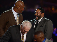 Canton, Ohio - August 6, 2015: Former NFL players Jerome Bettis and Charles Haley share a laugh after being introduced at the 2015 Pro Football Hall of Fame enshrinement dinner in Canton, Ohio August 6, 2015.  (Photo by Don Baxter/Media Images International)