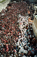 Palestinian worshipers pour out from  Al Haram Al Sharif as they leave Jerusalem's Old City following the Holy Friday Muslim prayers of the holy fasting month of Ramadan, 1996.