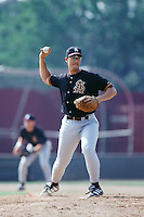 Kaipo Spencer of the Arizona State Sun Devils pitches against the USC Trojans during the 1996 NCAA baseball season at Dedeaux Field in Los Angeles, California. (Larry Goren/Four Seam Images)