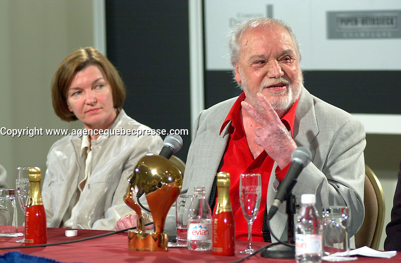 Aug 25th FILE PHOTO of<br /> Spanish actor FRANCISCO RABAL(R)  at a presse conference where he was presented a Special Grand Prize of the Americas by the World Film Festival's Vice- President and founder ;Dani&Euml;le Cauchard<br /> , August 25th, 20001 in Montreal , Canada.<br /> <br /> Rabal just died on the plane back home<br /> <br /> Born in &iexcl;guilas, Spain in 1925, Francisco Rabal . <br /> In 1950 he won his first real stage roles. Luis Bu&Ograve;uel saw him in Historias de la radio and decided to cast him in the lead role of his new film to be shot in Mexico, NAZAR&Otilde;N. This marked the beginning not only of Rabal's international career but also his lifelong friendship and collaboration with Bu&Ograve;uel - including such masterpieces as VIRIDIANA (1961) and BELLE DU JOUR (1967).<br /> As a result of his performances in Bu&Ograve;uel's early films, Rabal was sought after by many of the era's top international directors - Antonioni (THE ECLIPSE), Rivette (THE NUN), Visconti (THE WITCHES) - as well as directors of the so-called &quot;new Spanish cinema&quot;, in particular Carlos Saura, Miguel Picazo, Antonio Bardem and Jorge Grau. He made his American feature debut in 1977 in William Friedkin's SORCERER and won best actor awards at several festivals, including Cannes 1984 for his role in Mario Camus's THE HOLY INNOCENTS (!984) and the Montreal World Film Festival for his performance in Alain Tanner's THE MAN WHO LOST HIS SHADOW (1991).<br /> Rabal remained very active through the 1980s and 1990s, appearing in films by Pedro Alm&Ucirc;dvar, Saura, Eliseo Subiela and Arturo Ripstein. In 1999 he played the title role in Saura's GOYA IN BORDEAUX shown at the 1999 Montreal Festival, a performance which won international critical acclaim.<br /> Rabal's cinematic heritage continues in the persons of his actress-daughter Teresa Rabal, director-son Benito Rabal and actor-grandson Liberto Rabal.<br /> <br /> Photo by Pierre Roussel / Getty Images News Service (ON SPEC)<br /> <br /> <br /> NOTE : Nikon D-1 JPEG opened with QUIMAGE ICC profile , saved as Adobe RG 1998 color space.