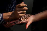 Hana Tattoo during the Balaju mela Hindu bating festival, Kathmandu, Nepal
