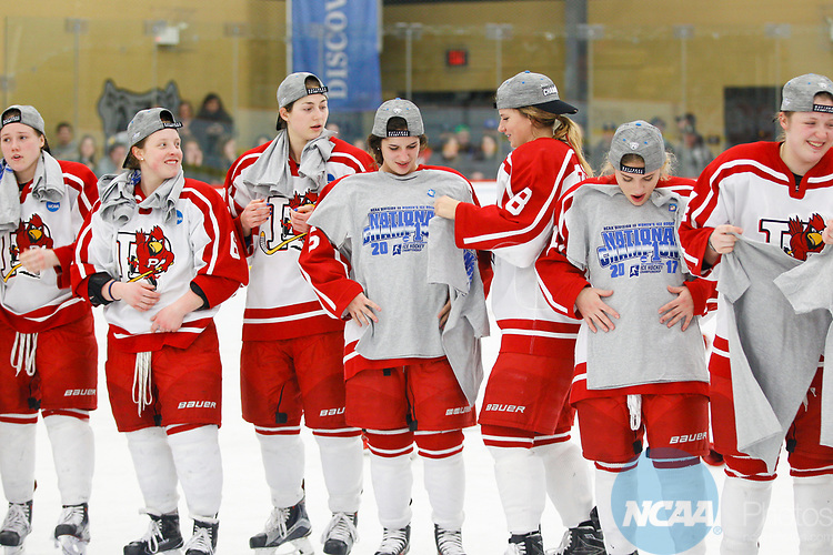 ADRIAN, MI - MARCH 18: The Plattsburgh State team examine their championship tee shirts after winning the Division III Women's Ice Hockey Championship held at Arrington Ice Arena on March 19, 2017 in Adrian, Michigan. Plattsburgh State defeated Adrian 4-3 in overtime to repeat as national champions for the fourth consecutive year. by Tony Ding/NCAA Photos via Getty Images)