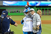7 March 2012:  Former FIU baseball player Tony Arguiz poses with the Miami Marlins mascot, Billy the Marlin, after throwing out the first pitch before the start of the exhibition game.  The Miami Marlins defeated the FIU Golden Panthers, 5-1, at Marlins Park in Miami, Florida.