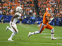 Charlotte, NC - December 2, 2017: Clemson Tigers quarterback Kelly Bryant (2) runs the ball during the ACC championship game between Miami and Clemson at Bank of America Stadium in Charlotte, NC. Clemson defeated Miami 38-3 for their third consecutive championship title. (Photo by Elliott Brown/Media Images International)