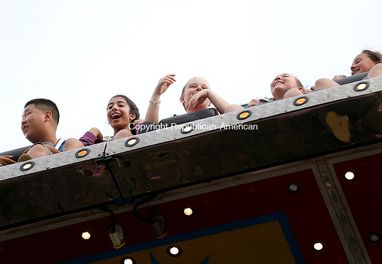 Beacon Falls, CT- 11 June 2015-061115CM04-  From left,  Derek Cha 14,  Fatima Khalid, 13, Hannah Gracy 13, and Alivia McCafrey, 13, all from Beacon Falls ride the Ali Baba during the annual Beacon Hose Carnival in Beacon Falls on Thursday.  The rides, food and entertainment continue Friday from 6 p.m. to 11p.m. then on Saturday from 3 p.m. to midnight with a parade at 6 p.m.  The event is put on by Beacon Hose Co. 1.      Christopher Massa Republican-American