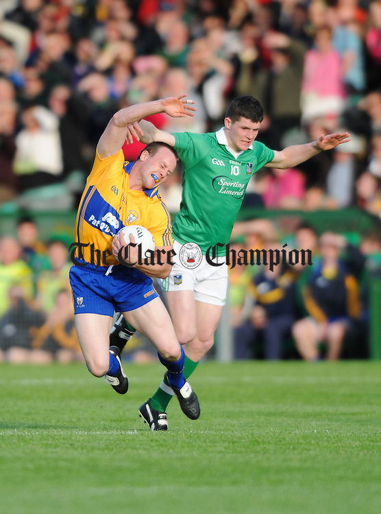 John Hayes of Clare in action against Ian Corbett of Limerick during their  Senior championship semi-final at the Gaelic Grounds. Photograph by John Kelly.
