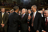 United States Secretary of the Interior Ken Salazar greets U.S. President Barack Obama as he leaves the House Chamber at the conclusion of his State of the Union address, Wednesday, January 27, 2010. Looking on are, from left, U.S. Secretary of Education Arne Duncan, Attorney General Eric H. Holder, Jr., and Secretary of Defense Robert M. Gates. .Mandatory Credit: Pete Souza - White House via CNP