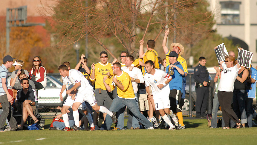 Fort Lewis College mens soccer fans react to a goal scored by a Fort Lewis player during 2007 RMAC semifinal game against Metro State College.
