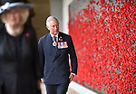 AUSTRALIA, Canberra : Britains Prince Charles walks down the Australian War Memorial cloisters to place a poppy, Canberra, Wednesday, November 11, 2015. Prince Charles and Camilla, Duchess of Cornwall, are on a six day official tour of Australia.  AFP PHOTO / POOL/ MARK GRAHAM