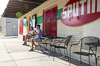 Young couple enjoy cocktails at an Eastside eatery in East Austin on East 6th Street.