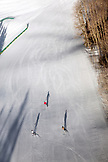 USA, Colorado, Aspen, skiers make turns under the gondola in the early morning, Aspen Ski Resort, Ajax