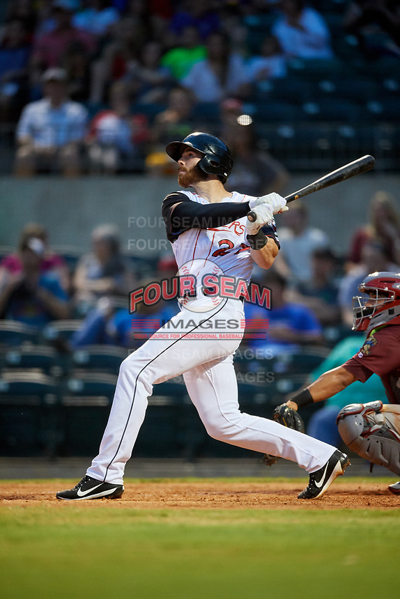 Arkansas Travelers first baseman Kyle Petty (27) follows through on a swing during a game against the Frisco RoughRiders on May 26, 2017 at Dickey-Stephens Park in Little Rock, Arkansas.  Arkansas defeated Frisco 4-2.  (Mike Janes/Four Seam Images)