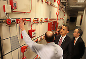 United States President Barack Obama, center, and Energy Secretary Steven Chu, right, get a tour of a fire alarm panel from teacher Rhett Roe, left, during a visit to the jobs training center at the International Brotherhood of Electrical Workers Local 26 headquarters on Tuesday, February 16, 2010 in Lanham, Maryland. President Obama also announced loan guarantees to expand an existing nuclear facility near Augusta, Georgia that will help create over 3,500 construction jobs and 850 permanent operations jobs, and will help provide power to over 550,000 homes and 1.4 million people. .Credit: Mark Wilson - Pool via CNP