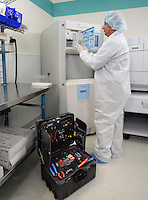 A healthcare tecnician from ASP, a division of Johnson & Johnson, repairs a sterilization machine.