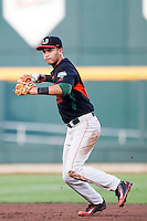 Miami Hurricanes shortstop Brandon Lopez (51) prepares to throw the ball to first base against the Florida Gators in the NCAA College World Series on June 13, 2015 at TD Ameritrade Park in Omaha, Nebraska. Florida defeated Miami 15-3. (Andrew Woolley/Four Seam Images)