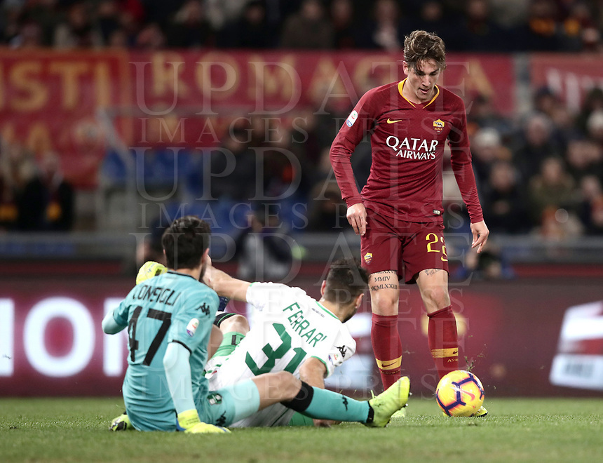 Football, Serie A: AS Roma - US Sassuolo, Olympic stadium, Rome, December 26, 2018. <br /> Roma&rsquo;s Nicol&ograve; Zaniolo (r) scores contrasted by Sassuolo's goalkeeper Andrea Consigli (l) and Gianmarco Ferrari (c) during the Italian Serie A football match between Roma and Sassuolo at Rome's Olympic stadium, on December 26, 2018.<br /> UPDATE IMAGES PRESS/Isabella Bonotto