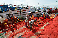 INDIA, Karnataka, Mangaluru, former name Mangalore, trawler in fishing port during monsoon, plastic fishing trawl nets and ropes which are a major source of plastic pollution of the oceans and dangerous for sea animals