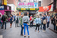 "The ""T. SQ Newsstand"" is debuted in Times Square in New York on Friday, October 9, 2015. Created by the artist Kimou ""Grotesk"" Meyer with Victory Journal and Juxtapoz Magazine, the pop-up displays and sells art and culture zines created by a litany of artists. It will be in business at the crossroads of the world until October 18. (© Richard B. Levine)"