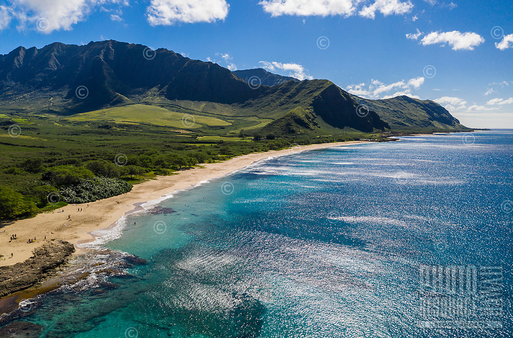 Makua Beach and Bay, West O'ahu, seen from above on a sunny day.