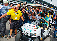May 26, 2017; Indianapolis, IN, USA; Fans and media surround IndyCar Series driver Fernando Alonso as he rides in a golf cart on pit road at the end of Carb Day for the 101st Running of the Indianapolis 500 at Indianapolis Motor Speedway. Mandatory Credit: Mark J. Rebilas-USA TODAY Sports